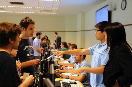 Students at Wharton playing a collaborative and competitive multiplayer simulation